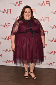 Chrissy Metz went ultra ladylike in a burgundy lace cocktail dress by Eloquii at the 2018 AFI Awards.