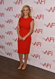 Reese Witherspoon went minimalist in a red twist-front sheath dress by Prada at the 2018 AFI Awards.