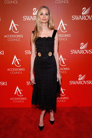 Lauren Santo Domingo kept it classic at the ACE Awards in a black lace corset dress with gold embellishments.