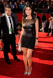 Emmanuelle looked fabulous on the red carpet in a sexy LBD with a leather bustier, sheer neckline and draped skirt.