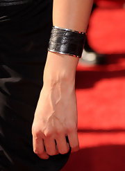 Emmanuelle paired her black satin dress with a textured cuff bracelet.