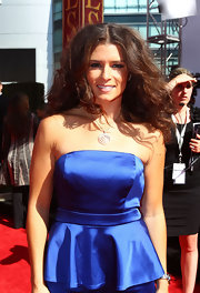 Danica paired her blue satin strapless dress with a silver pendant necklace.