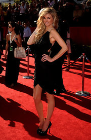 Marisa Miller showed off her long blonde curls while walking the red carpet at the ESPY Awards.