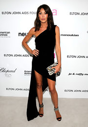 Tamara Mellon walked the red carpet at the elton John party donning an exotic zebra print clutch, which jazzed up her black one-shouldered dress.