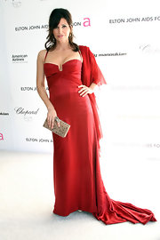 Gina Gershon was a pleasant surprise in her red satin dress at the Elton John party. She added some glam to her daring dress with a cute box clutch.