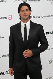 Fernando Verdasco looks downright dapper in a narrow black tie, reminding us why the retro neckwear has made such a big comeback this year.