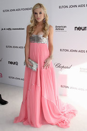 Tinsley Mortimer looked pretty in pink at the coveted Elton John party. She showed off a silver fringe clutch, which strangely matched her bodice.