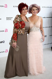 Kelly was pretty in pink wearing a feathered and silver beaded gown with a curled out light pink bob.