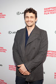 James Franco cozies up to the gray wool pea coat he layered over a basic blue tee.