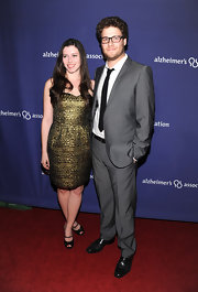Lauren Miller wore a textured bronze sweetheart dress.