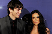 Actor Ashton Kutcher (L) and his wife, actress Demi Moore arrive at the 18th Annual