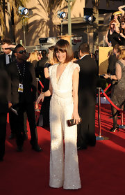 If anyone can rock a jumpsuit on the red carpet, it's the always gorgeous Rose Byrne! She selected a dazzling white Elie Saab number with a tasteful neckline plunge. Almost more notable was her newly cut bob, making this look refreshingly avant-garde.