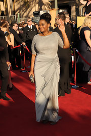 Octavia Spencer looked elegant on the red carpet in a silver beaded evening dress.