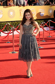 Ariel topped off her lacy cocktail dress with glittering pumps.