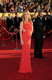 Kyra Sedgwick took the sultry approach to the SAG Awards in this red hot cutout dress from Emilio Pucci. She even revealed a recent rib tattoo that incorporated her and Kevin Bacon's initials.