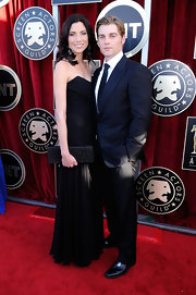 Courtney Vogel wore a black strapless chiffon dress to the SAG Awards.