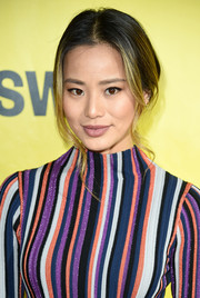 Jamie Chung pulled her hair back into a loose center-parted ponytail for the 2018 SXSW premiere of '1985.'
