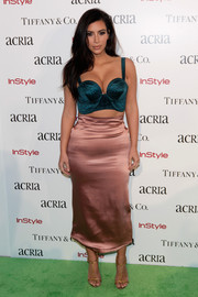 Kim Kardashian did some color blocking with this pink midi pencil skirt and teal crop-top combo, both by Ulyana Sergeenko.