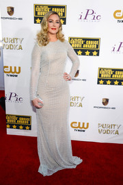 Elisabeth Rohm went for simple elegance at the Critics' Choice Awards in a long-sleeve white Carmen Marc Valvo gown with subtle beading.