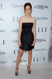 Emma Watson kept the minimalist-chic look going with a pair of black platform sandals by Calvin Klein.