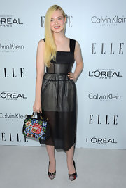 We would love to get our hands on this caged corseted LBD Elle wore to the Women in Hollywood Celebration.