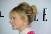 Emma added volume to her crown and pulled the rest of her hair into a tiny ponytail for the 'Elle' soiree.