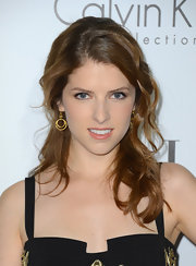 Anna Kendrick teamed her gorgeous 'do with a pair of dangling gold hoops by Liv Haley.