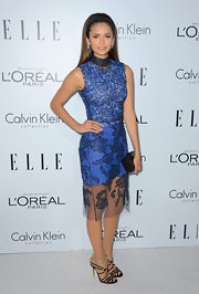 Nina Dobrev was a standout at the 'Elle' celebration in this blue lacy cutout dress.