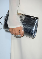Rachel Zoe's metallic clutch was an eye-catching addition to her ethereal white dress.
