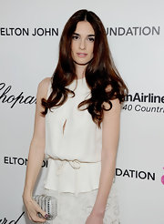 Paz Vega added sparkle to her ethereal white gown with a crystal encrusted metallic silver box clutch.