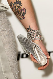 Kelly Osbourne paired her elegant look with a diamond clad bangle bracelet.