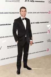Chace was decked out in a classic black suit at Elton John's Oscar party.