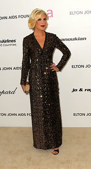 Tori was a vision at the Oscar party in a bead saturated evening gown.