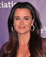 Kyle Richards turned up at the 19th Annual A night at Sardi's wearing gold hoop earrings equipped with sparkling gemstones.