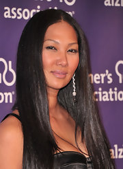 Kimora Lee Simmons paired her long straight locks with dangling gemstone earrings.