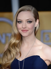 Amanda Seyfried swept her ash-blonde curls over one shoulder at the  2013 SAG Awards.