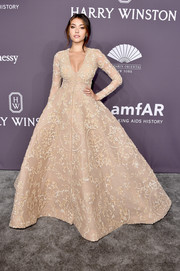 Madison Beer looked absolutely stunning in an embroidered nude princess gown by Ashi Studio Couture at the amfAR New York Gala.