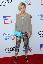 Kathleen Robertson looked funky in a loose taupe blouse with shoulder cutouts at the Children Mending Hearts Style Sunday.