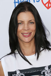 Liberty Ross styled her layered hair in a center part for the Children Mending Hearts Style Sunday.