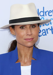 Minnie Driver covered up with a banded white straw hat at the Children Mending Hearts Style Sunday.