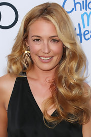 Cat Deeley showed off her gorgeous bouncy curls at the Children Mending Hearts Style Sunday.