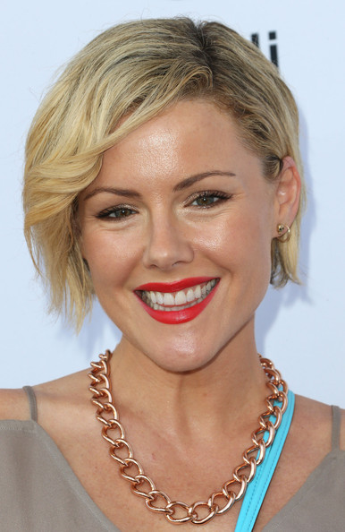 A swipe of bright red lipstick totally perked up Kathleen Robertson's look during the Children Mending Hearts Style Sunday.