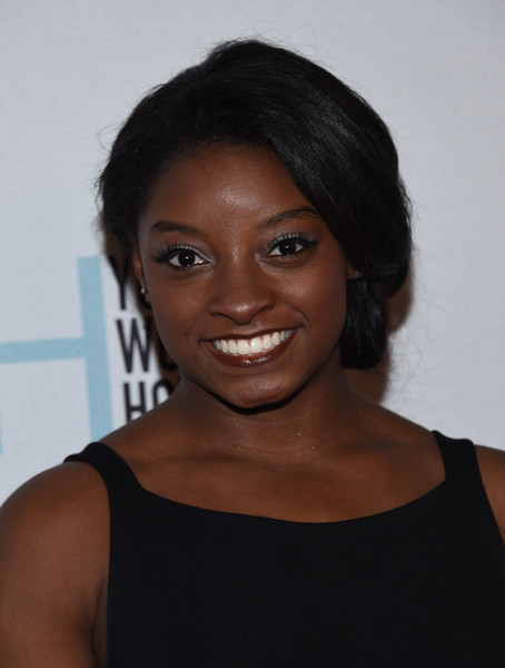Simone Biles got all glammed up with this side chignon for the Marie Claire Young Women's Honors.