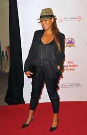 Tia Carrere hit the Lint Roller red carpet wearing a charcoal jumpsuit and pointy pumps.