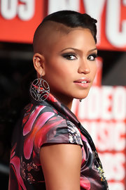 Cassie paired her printed cocktail dress with diamond earrings that radiated on the star.