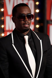 Sean Combs complemented his modern suit with a pair of rectangular sunglasses for his 2009 MTV VMA look.