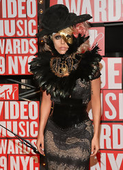 Lady Gaga showed off her unique style at the MTV Video Music Awards in a wide lace hat.