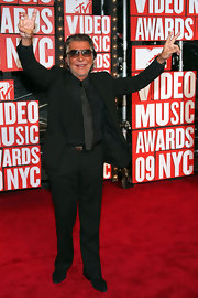 Roberto Cavalli dressed in all black while hitting the MTV VMA's.