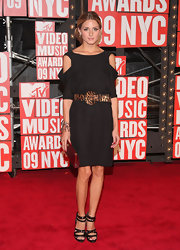 Olivia adds texture and color to her LBD by going for the leopard print belt.