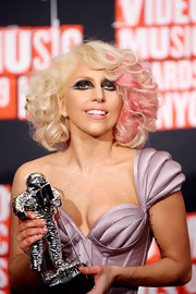 Lady Gaga added a sparkling touch to her cool cat eyes with a few dashes of iridescent sparkle shadow.